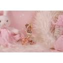 Bébé cigogne rose sur boîte