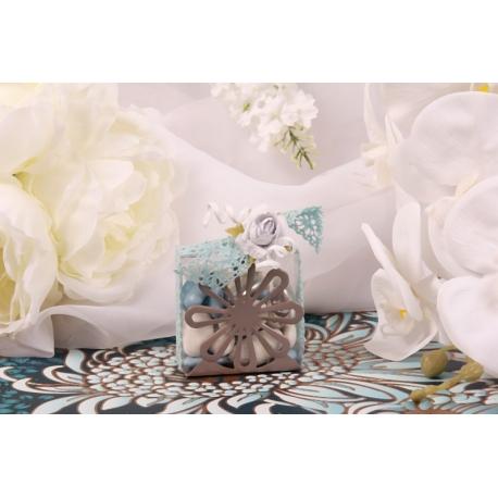 Fleur bleue sur support gris