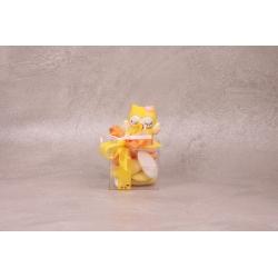 Hibou jaune sur cube